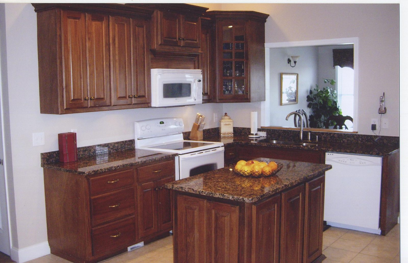 baltic brown kitchen with cherry cabinets and white appliances Quotes