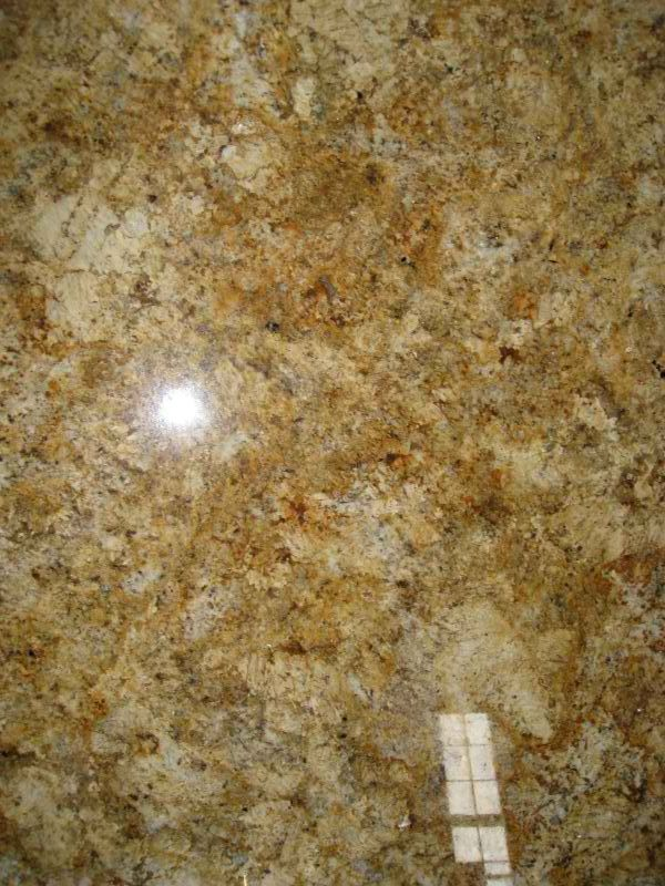 Granite countertop warehouse gold yellow and cream for Cream colored granite countertops