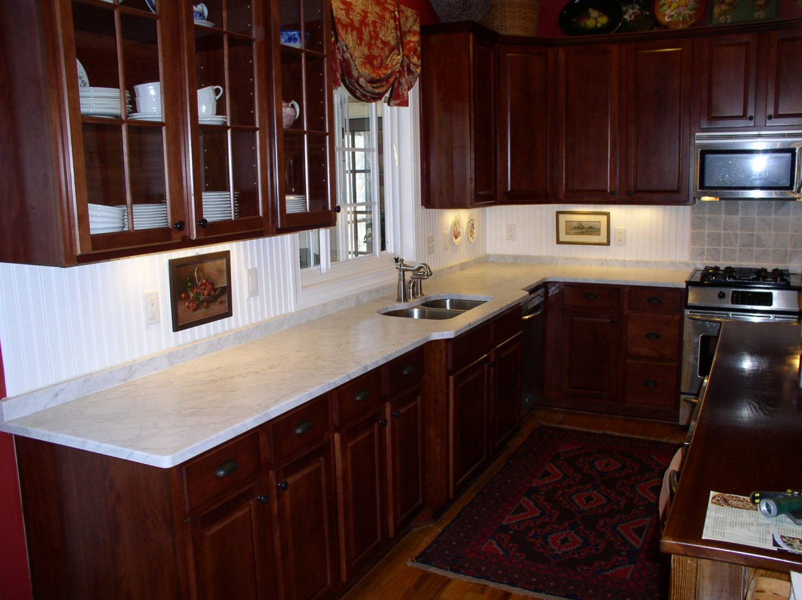 Baltic brown kitchen with cherry cabinets and white for Cherry kitchen cabinets with white appliances