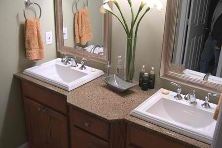 Baltic Brown vanity with tile backsplash and white sinks