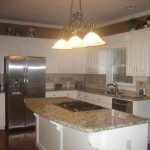 Black and white cabinets with Millenium Cream granite