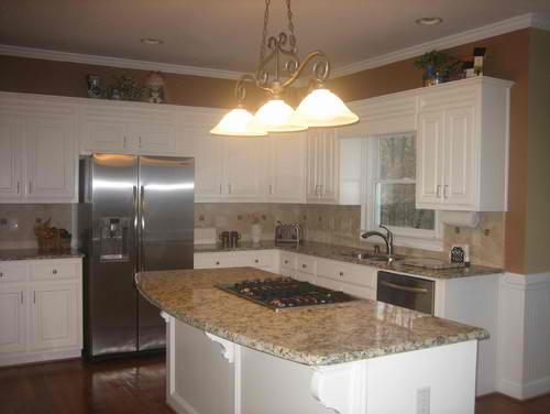 Black and white cabinets with Millenium Cream granite