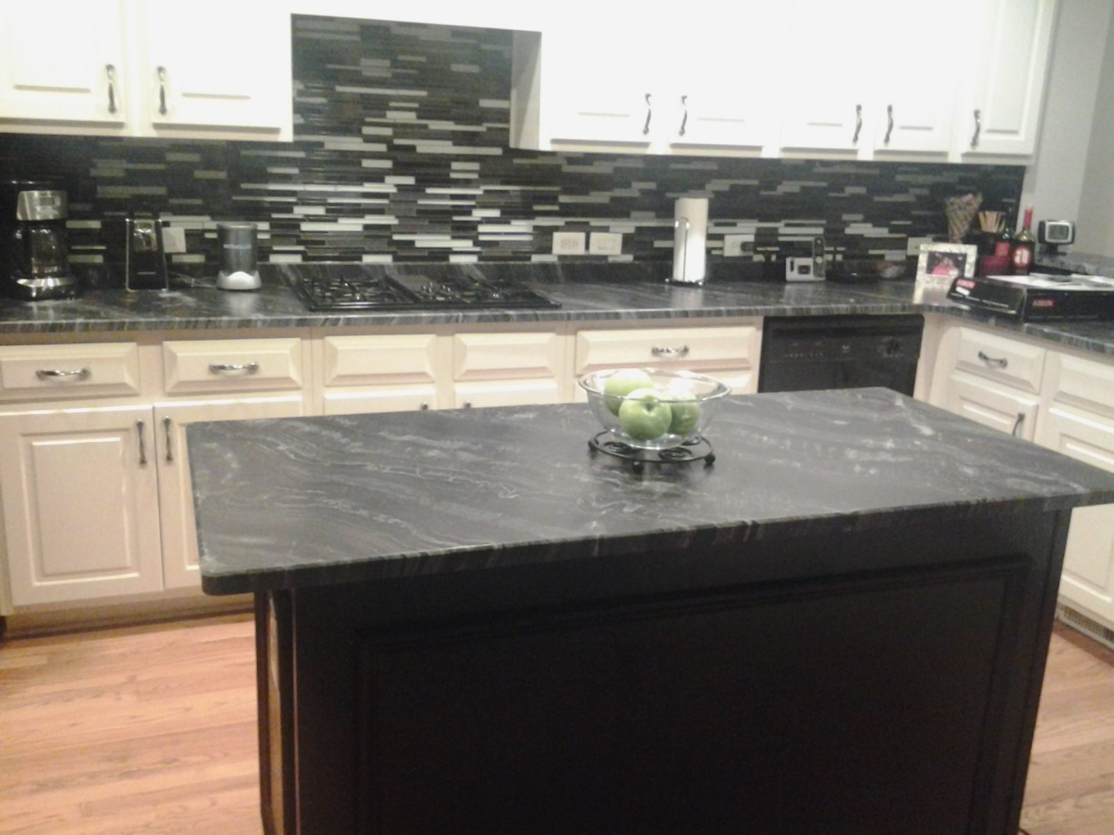 a granite pin black painted cabinets leathered countertops with mosaic backsplash pearl and white leather