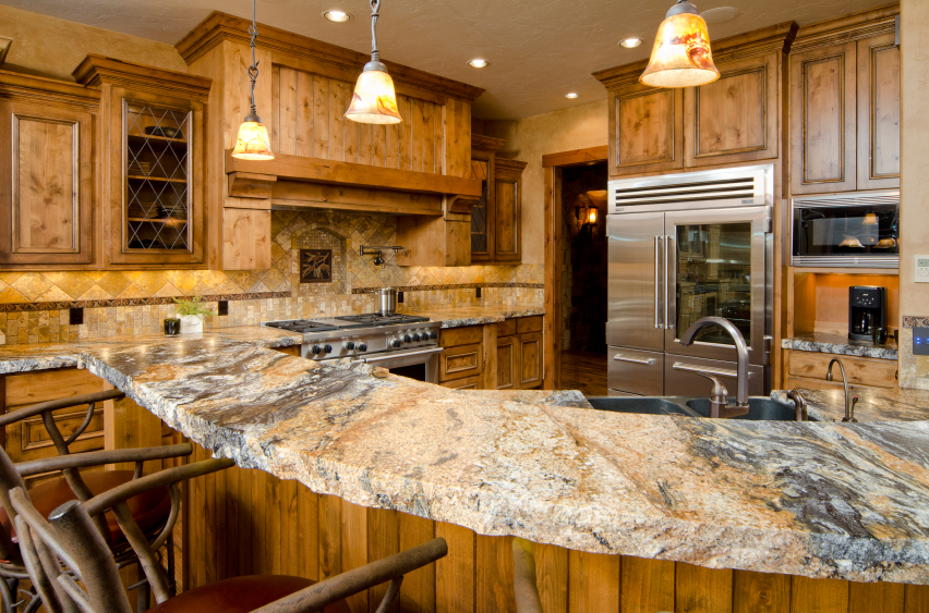 a beautiful kitchen with stone countertops - Granite Kitchen Countertops