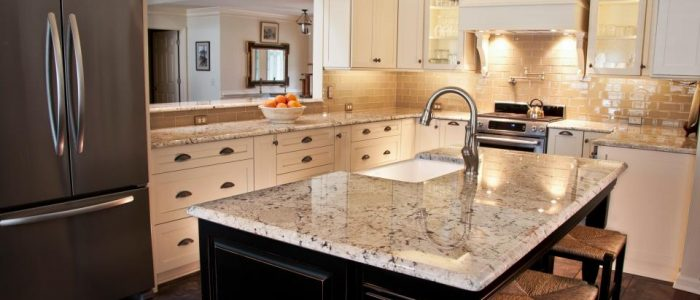 White Galaxy Granite with an almond glass tile backsplash